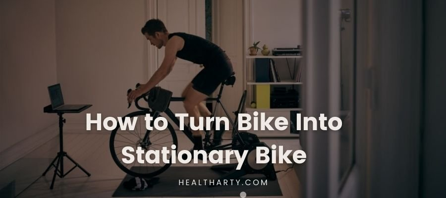 A man working on turning bike into stationary bike